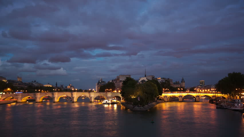 Pont Neuf bridge over the river Seine in Paris timelapse at night