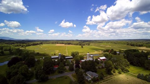 Farm Summer AERIAL. Working farm aerials, barn and buildings. Upstate New York. Float over differt views of a small farm.