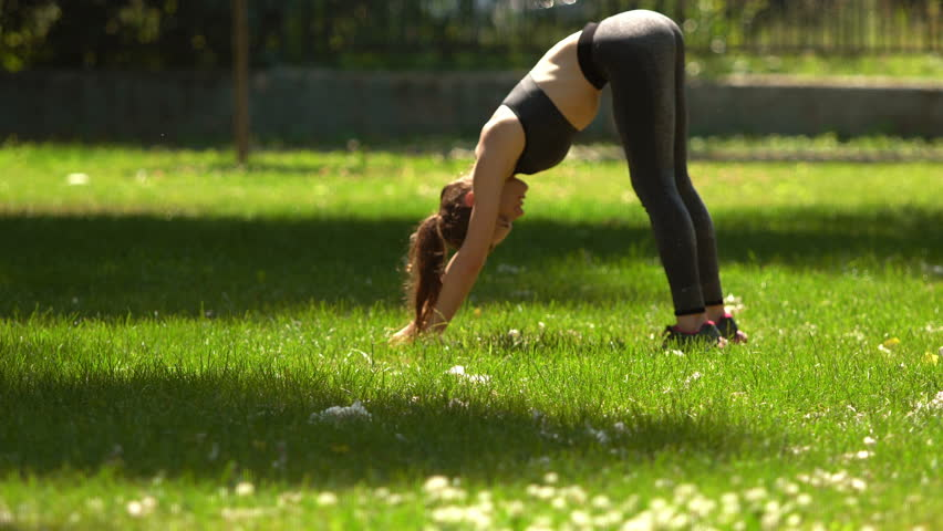 Pretty Girl is doing Yoga in Park. #17621335