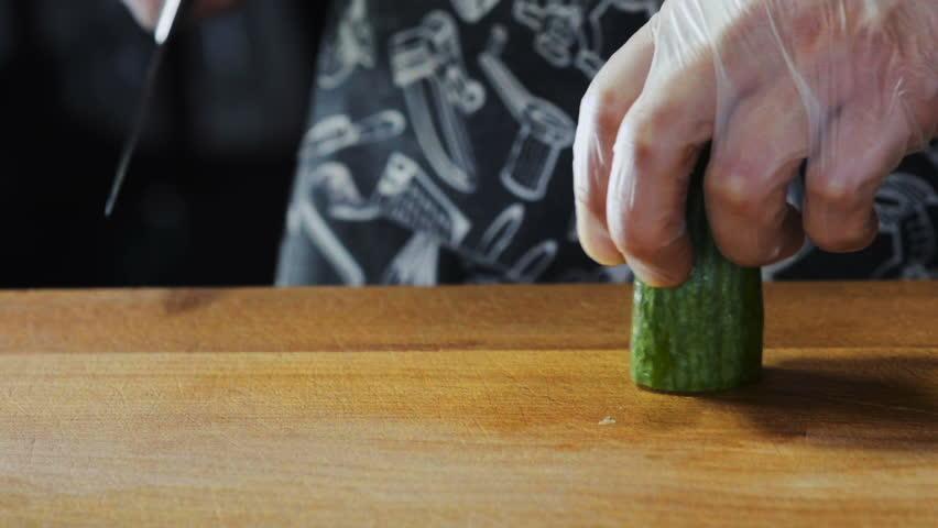 Chef Cuts Cucumber On Board   Shutterstock HD Video #17698135