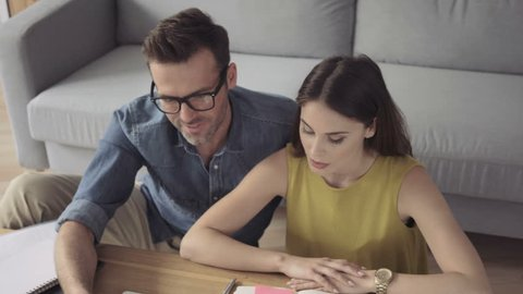 Happiness - couple at home calculating finances