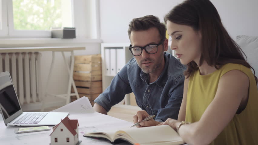 Couple, architects at home planning new house design   Shutterstock HD Video #17710237