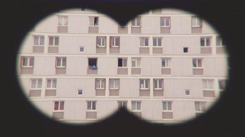 Pov Binoculars Spying On Apartments. Pov binoculars spying on neighbors in the front building.
