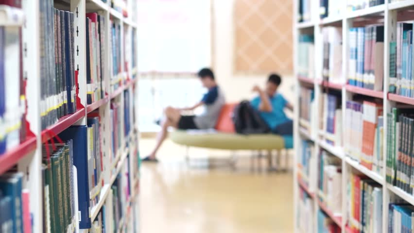 Bookshelf in Library People Reading Stock Footage Video (100% Royalty-free)  17727475 | Shutterstock