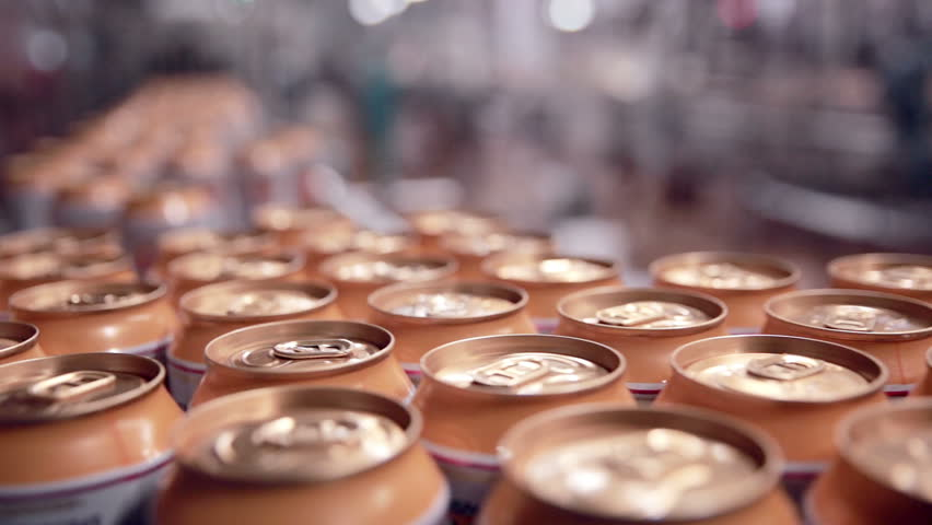 Soda cans production line on Pop and Soda, carbonated drink, factory.