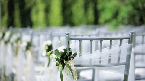 Dolly of rows of chairs at a wedding ceremony