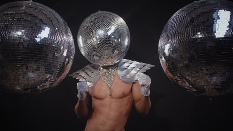cool muscular man with disco ball for a head dancing and posing. perfect video for fashion, style, disco, clubs and events. mr disco ball