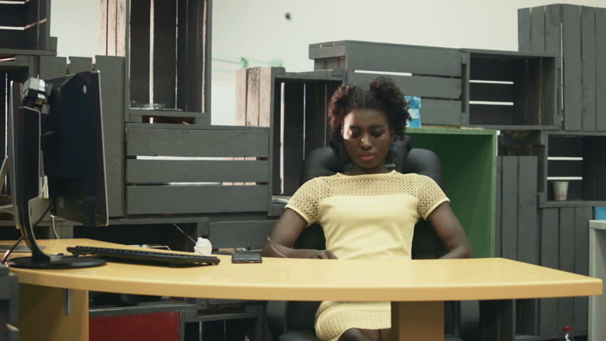 African Female Worker In Office Chair After Workday Using Gles Of Virtual Reality Hd Stock