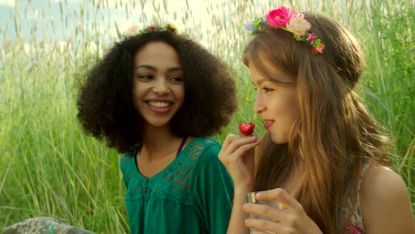 Young girls eating strawberry and cheering | Shutterstock HD Video #17777155