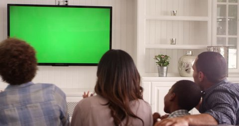 Rear View Of Family Watching Green Screen TV Shot On R3D
