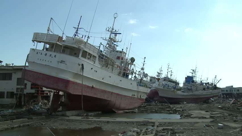 KESENNUMA, JAPAN - CIRCA APRIL 2011: Ships rest inland in tsunami stricken port