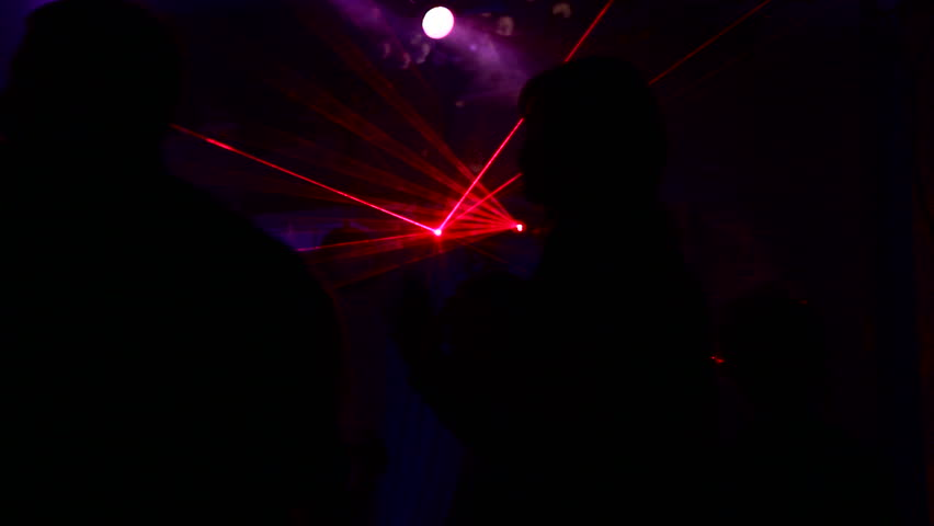 Dancing at the disco. People dancing at a disco where there is a beautiful laser show. | Shutterstock HD Video #1781075
