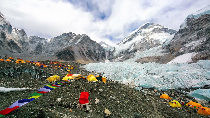 Everest Base Camp colored tents, at an altitude of 5,364 metres (17,598 ft). These camps are rudimentary campsites on Mount Everest that are used by mountain climbers during their ascent and descent.