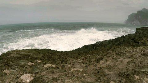 Ocean surf near Al Mughsayl beach in Salalah, Oman during monsoon season