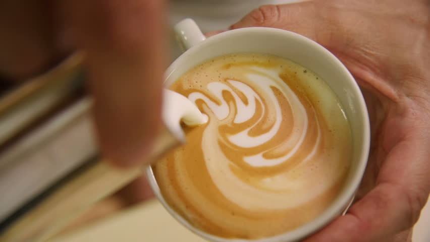 Making of cafe latte art, heart shape
