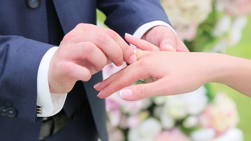 Gold Wedding Rings And Hands Of Just Married Couple Of Bride And