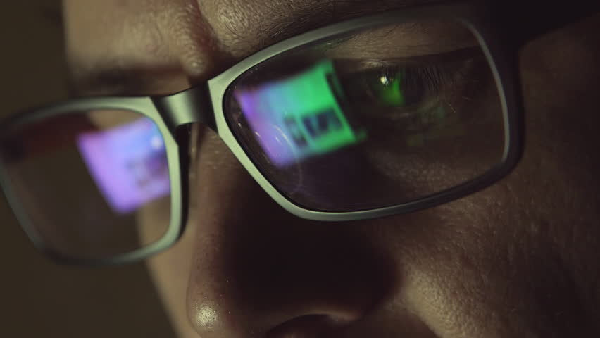 The reflection at the glasses of man: looking a site (side view) | Shutterstock HD Video #17849545
