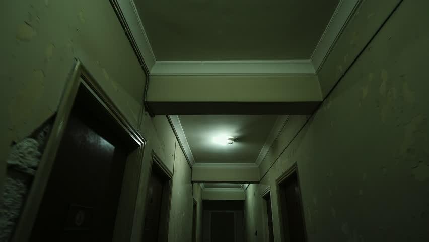 Old apartment buildinglong dark hallwayacking in on the old apartment buildinglong dark hallway pov walki towards door at the endacking sciox Image collections