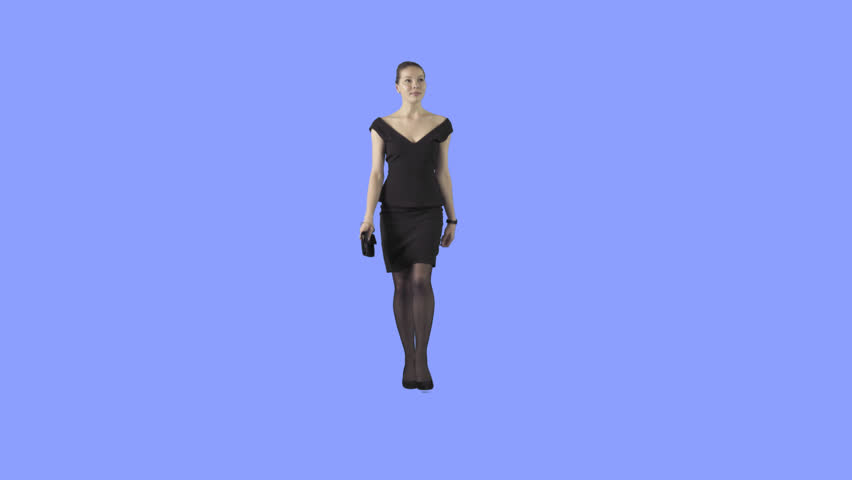 Elegant young woman in black short formal dress is walking at the camera. Camera is static. Lens 85 mm. Footage with alpha channel. File format - .mov, codec PNG+Alpha