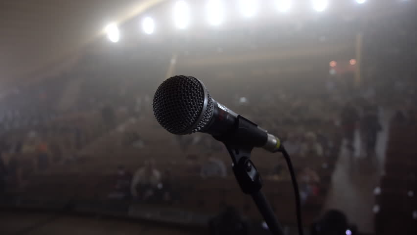 Auditorium in the Haze, a Large Plan of the Microphone on Stage, Spotlight, Backlight, People Gather in the Hall and Sit on Seats, Waiting For Performances, 4k