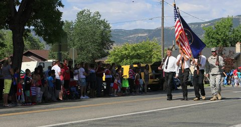 MORONI, UTAH - 4 JUL 2016: 4th July parade American Legion USA Flag. Small rural community annual celebration. Family and friends gather to cheer. Fun way to celebrate freedom and pride.