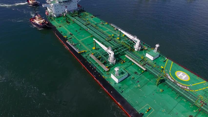 Oil tanker under tug tow