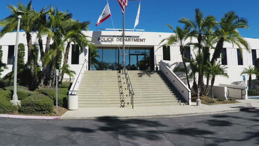 NEWPORT BEACH, CA/USA: June 6, 2016- A wide angle shot of the exterior face of the Newport Beach Police Department. A long set of stairs leads up to the front entrance doors.