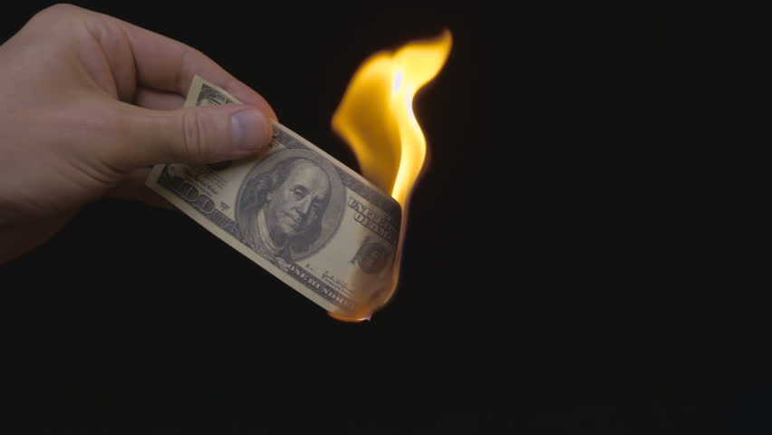 Hand holds 100 dollars on a black background and ignites her by lighter. Hand holding a burning $ 100. S-log - High Dynamic Range. Slow motion, high speed camera, 250fps #17972290