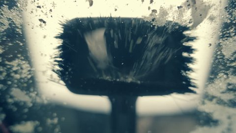 Brush vacuum cleaner sucks up dust and garbage.  Bottom view. Slow motion, high speed camera, 250fps