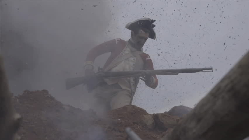 VIRGINIA - OCTOBER 2014 - Reenactment, large-scale, epic American Revolutionary War anniversary recreation -- middle of battle.  Continental Soldiers fire muskets and attack earthworks, explosions.