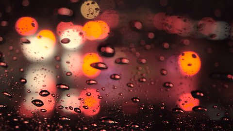 UHD footage : close up of water and water drop at front car window in traffic jam