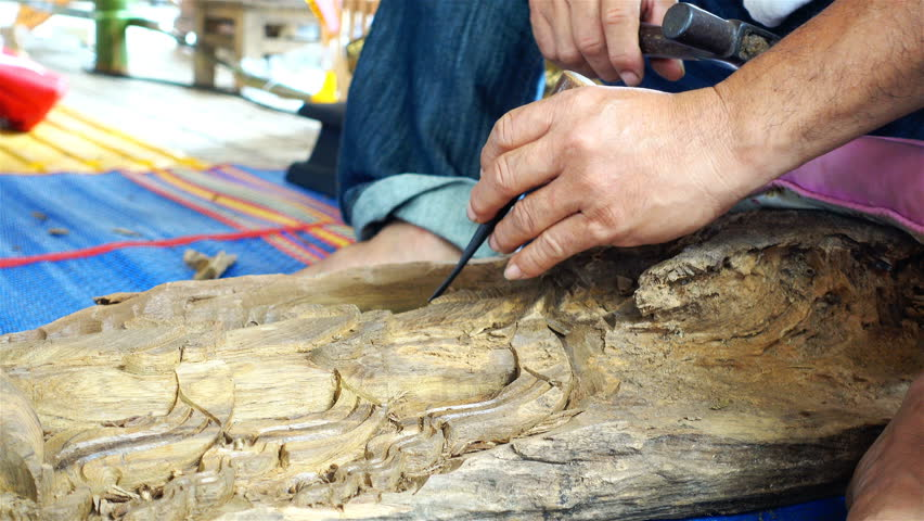 Man Making Wooden Souvenirs And Carving Wood Traditional Handicraft