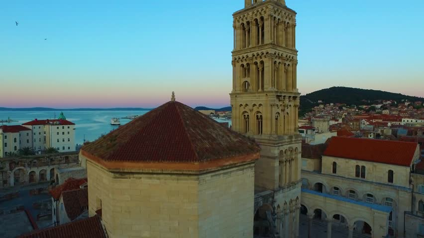 Diocletian's Palace's peristyle in front of Cathedral of Saint Domnius' bell tower in Split, Croatia at morning. | Shutterstock HD Video #18052075