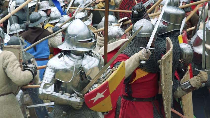 LIBUSIN, CZECH REPUBLIC - APRIL 23, 2016: Warriors defend and attack in mediaeval battle in reenactment - close up warriors in armour  | Shutterstock HD Video #18116104