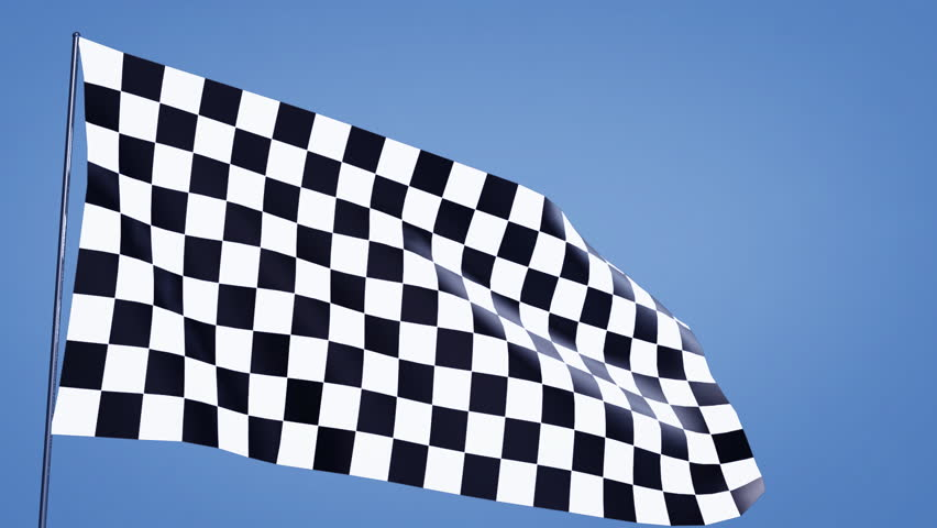 close up of checkered flag in the blue sky