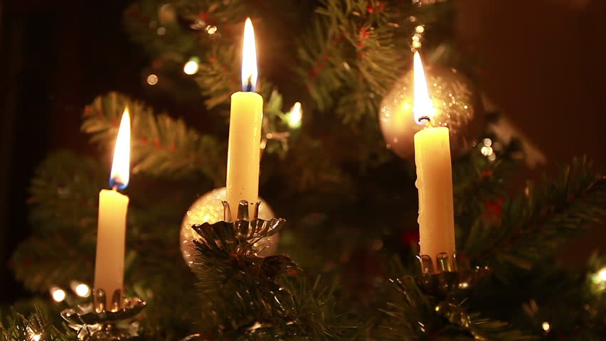 Closeup Of Three German Burning Clip On Candles A Christmas