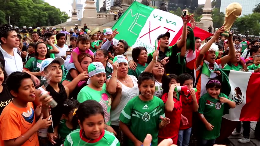 Mexico City/Mexico, June 16.  Soccer fans cheering and celebrating on the street and  parks, in Mexico City.
