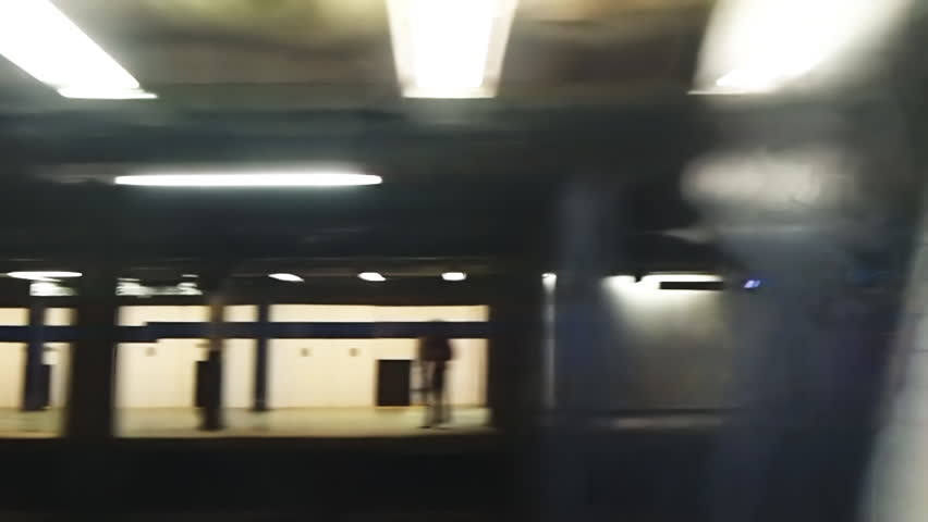 new york subway train coming into the station