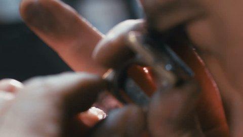 Macro shot of a diamond polisher working and polishing a diamond