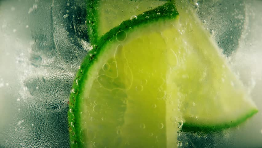 Cold cocktail with lime, tonic and ice, closeup | Shutterstock HD Video #18273025