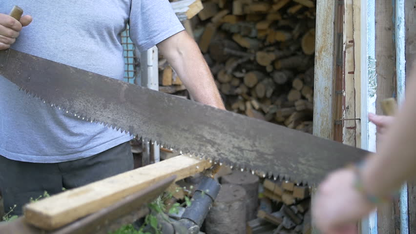 Two men sawing wood, saw Russian friendship, slow motion | Shutterstock HD Video #18274705