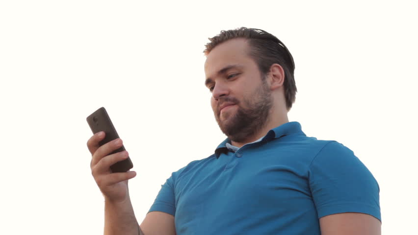 Smiling bearded man using phone | Shutterstock HD Video #18282424