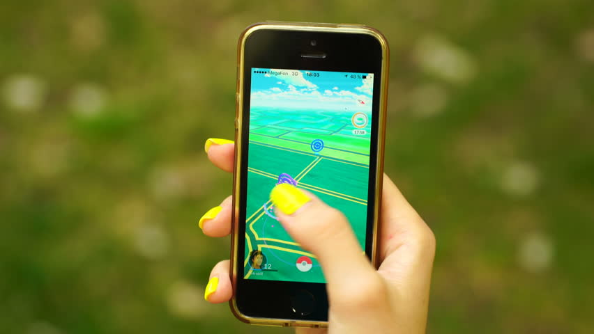 Samara, Russia - July 26, 2016: woman playing pokemon go on his iphone. pokemon go multiplayer game with elements of augmented reality.