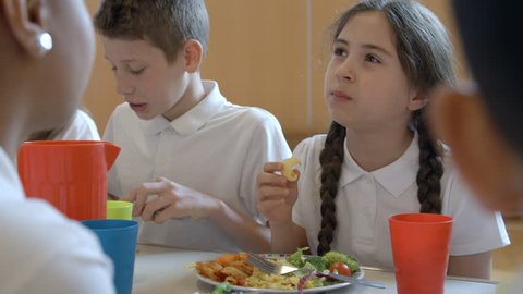 Close Up Of School Pupil Having Lunch In Canteen Shot On R3D