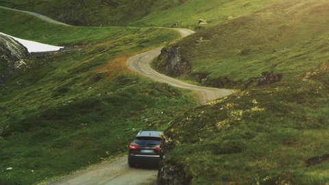 Aerial Shot of Car Moving on Curvy Mountain Road in Norway.