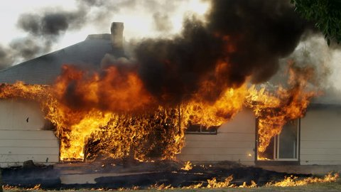 House on fire burning during a controlled burn in Idaho.
