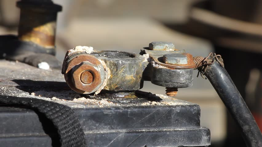 Closeup Of Old Car Battery Terminal Nut Spun By Hand And Wrench