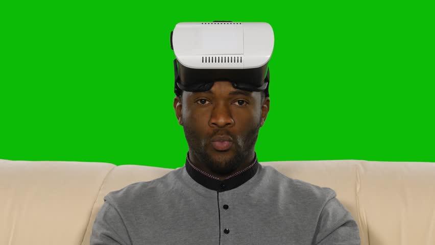 Man in the mask of virtual reality. Green screen | Shutterstock HD Video #18371995