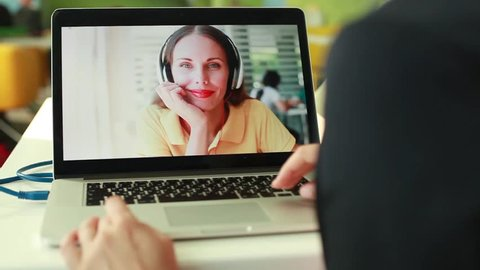 woman doing videocall using laptop