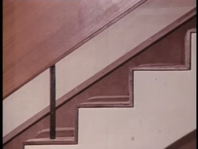 Close-up woman's legs as she walks down staircase